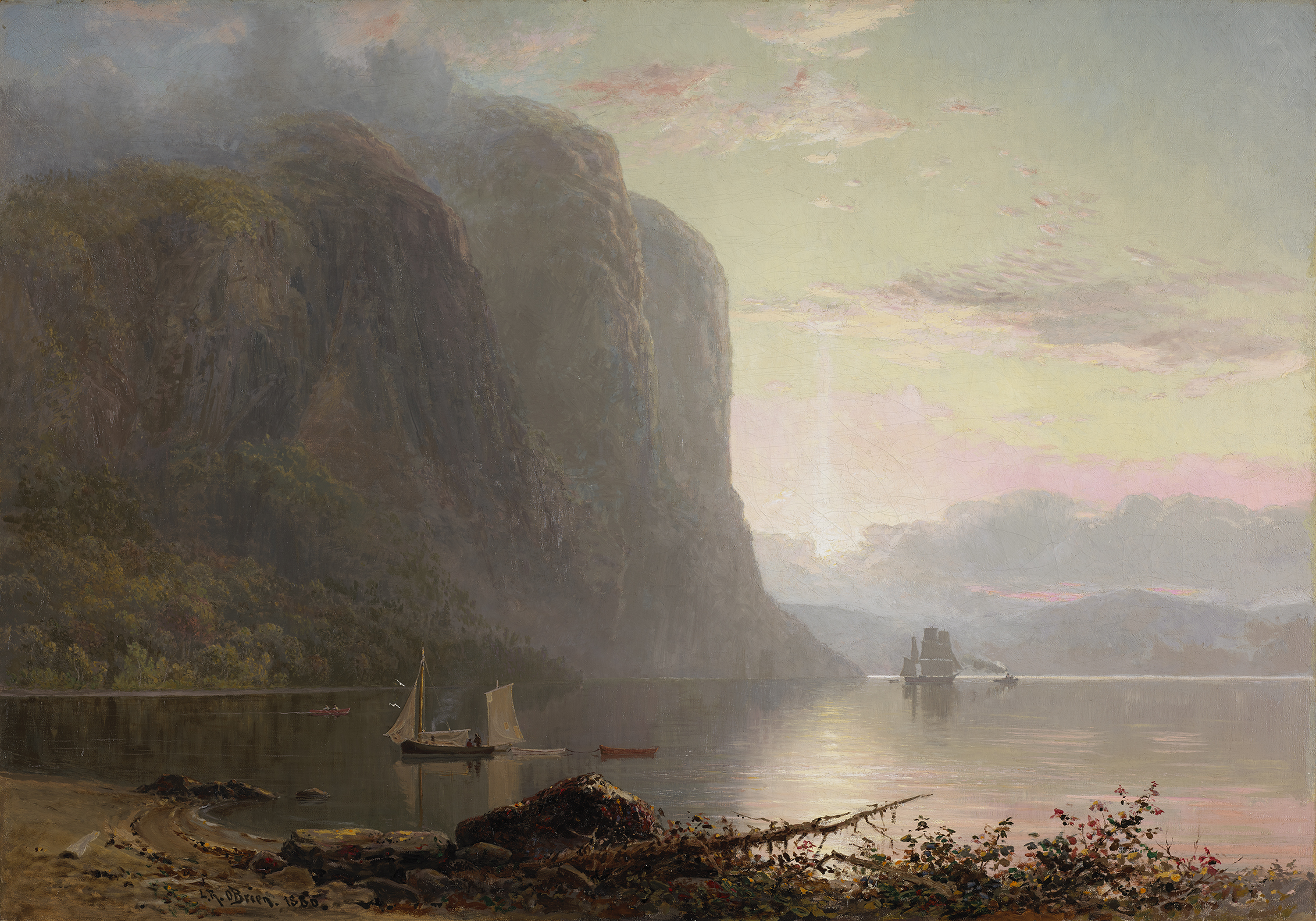 Captured from the riverbank, this landscape shows a luminous sunrise through a morning mist on the Saguenay fjord. Two ships are discernible in the distance, and small boats float at the foot of steep cliffs in the left half of the composition.