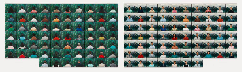 This picture shows two mosaics of photographs of people of Korean descent. The first sixty-seven pictures show the subjects from behind looking at a painted landscape. The other sixty-seven show them full-face in front of a painting of mountains.