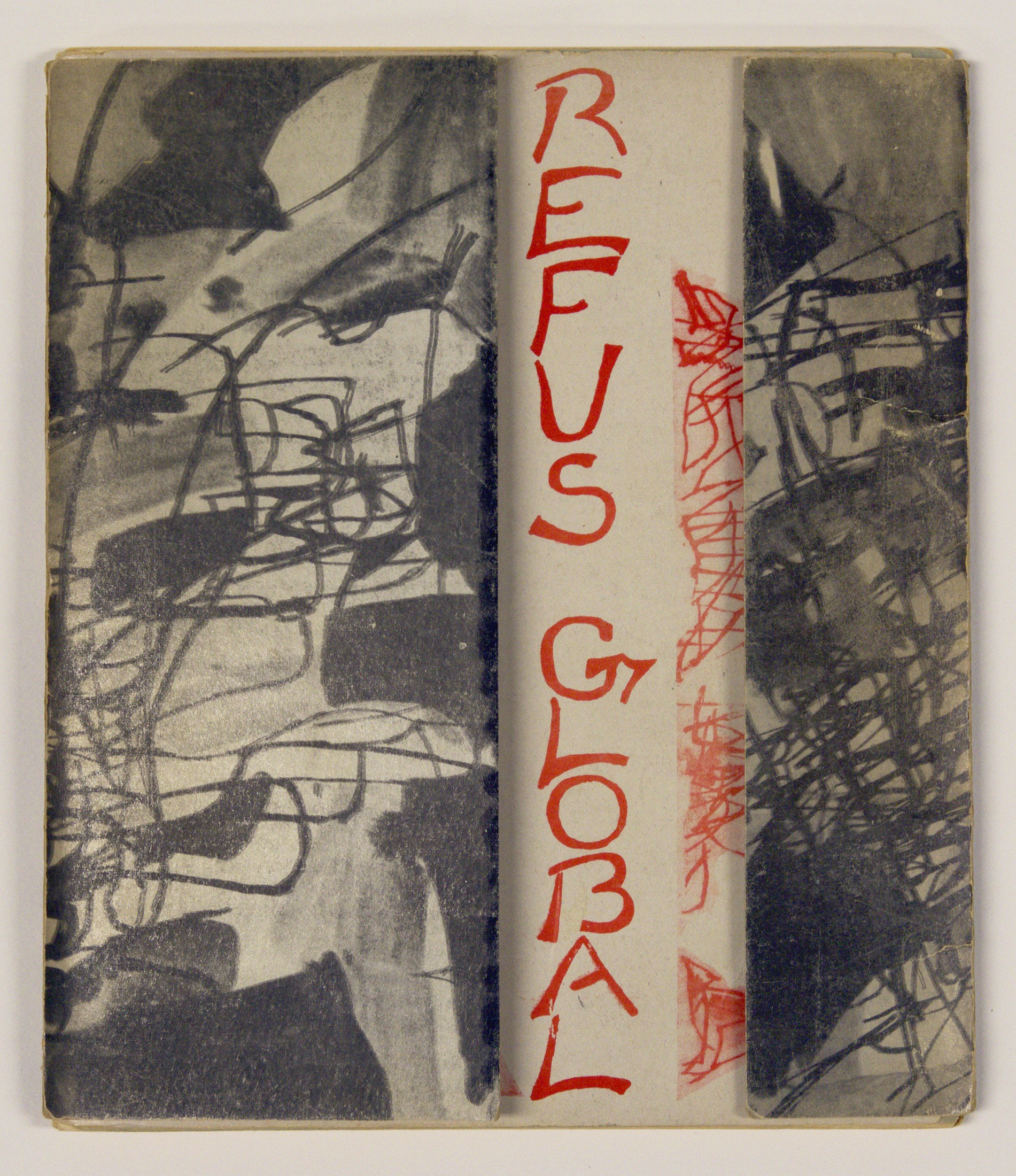 "The title ""Refus global"" is handwritten vertically in red ink on the title page of a book pamphlet. It is visible between the half-open flaps of the cardboard cover, which are decorated with non-figurative motifs in black and white."