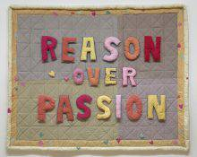 "This rectangular textile work is made of pieces of fabric stitched together like a quilt. Against the checkered background, brightly coloured letters spell out the words ""Reason over passion."""