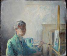 A woman with a blurred face is painting a picture on an easel. The turquoise form sketched on the canvas is the same colour as the artist's shirt. Behind her are a vase, also turquoise, and picture frames leaning against the wall.