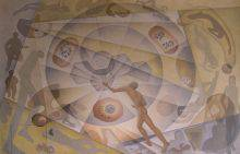 This horizontal mural in tones of yellow and ochre depicts a man, seen from the back, reaching toward a radiating hexagon at the centre of a spiral. Round and polygonal translucent forms revolve around the central motif.