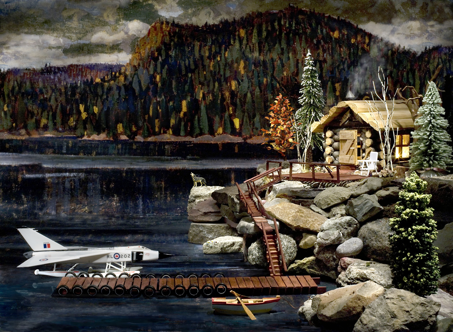 In this autumn scene set on a mountain lake, a log cabin is perched on a rocky point. Moored at a wooden dock is a scale model of the CF-105 Arrow, retrofitted as a sea plane and bearing the Royal Canadian Air Force roundel.