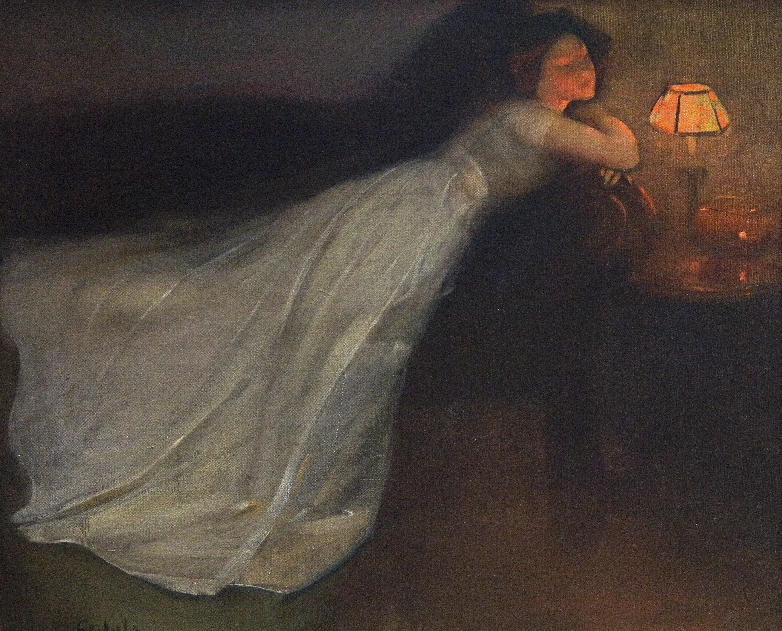 A woman is lying prone on a divan in a long white dress that spreads across the lower left side of the painting. Her face is bathed in the yellow-orange glow of a lamp and a few candles on a table.