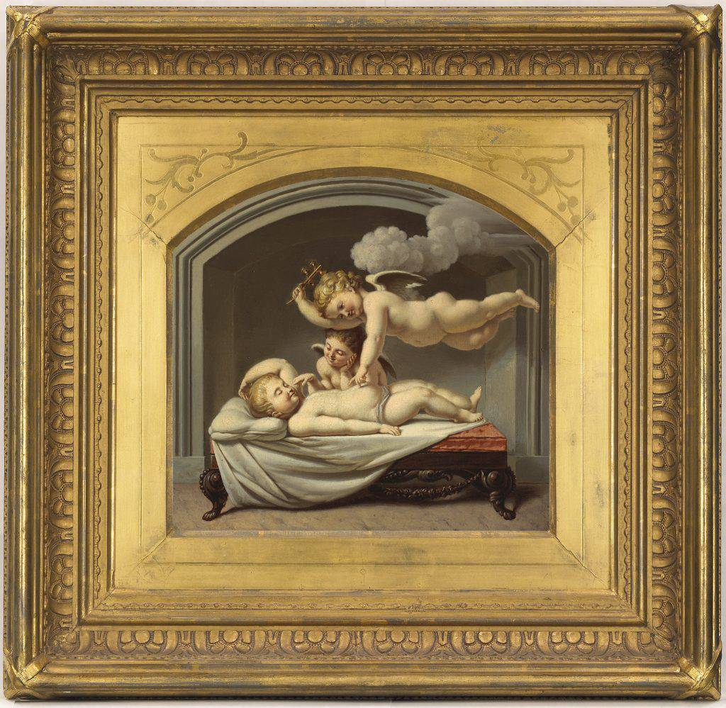 Two cherubs are watching over a child lying on a bed and smiling it its sleep. One cherub is beside the bed, while the other hovers above it, shaking a rattle and gently touching the child's stomach with a fingertip.